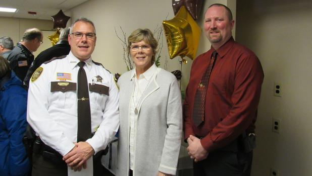 Retired Polk County Sheriff, Barb Erdman (center) with the new Polk County Sheriff, Jim Tadman (left) and his Chief Deputy Michael Norland (right) during a retirement celebration for Barb held at the Sheriff's Office Community Room last Friday.