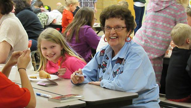 Everyone's favorite Grandma, Dorothy Sandberg sat with Ella Strom during Bingo for Books last Monday night at WEM School.