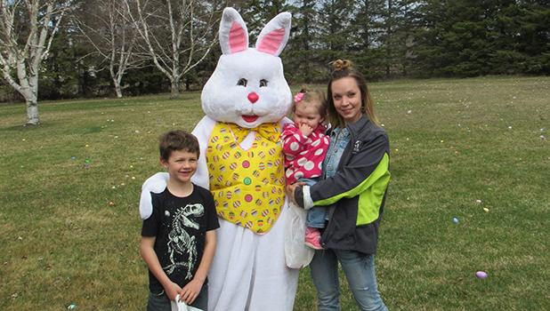 Gage and Baily Bauer get to visit with the Easter Bunny along with mom, Mary.