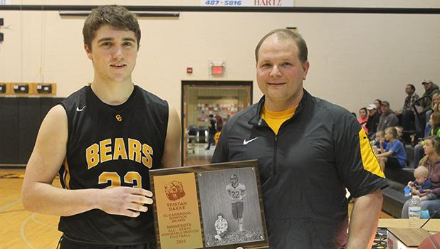 Clearbrook-Gonvick Head Football coach Casey Kroulik presented Tristan Bakke with his Minnesota All-State plaque at the last home basketball game. Photo by Kendehl Ballard.