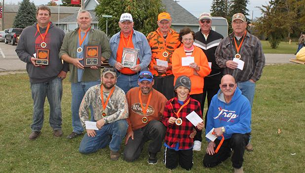 Pumpkin Day winners in Gonvick were Ole Engebretson, Bob Edevold, Tucker Johnson, Frank and Annie Bergh, Marvin Marty and Al Danielson standing. In the front Matt Wickham, Charlie Bergh, Trever Solberg and Dave Marty.