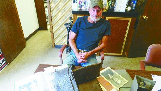 Joel Wraa is interested in history and he is shown with his collection of World War I letters and pictures from his great uncle Walter Berg.