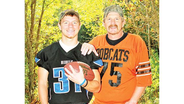 Matt Vettleson wearing his Rebels football jersey with his dad Alan wearing his Bobcat Jersey.