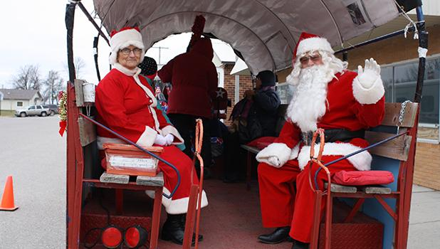 Mrs. Claus  and Santa took a ride around Oklee on the sleigh rides offered in Oklee.