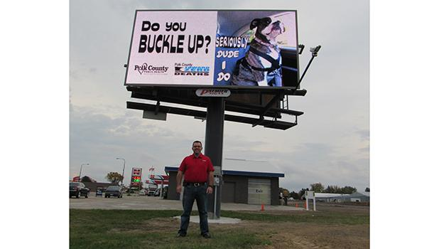 Jordan Gunufson is the newest member of Mentor based Premier Signs. Here, Jordan stands in front of the newest digital billboard that Premier Signs is using to promote area business, located on the east side of Fosston on Highway 2.