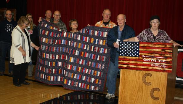 Wallace Nelson of Oklee was presented a Quilt of Valor by the Thief River Falls Quilting Club and it was presented to him by Oklee American Legion Auxiliary member Shirley Dessellier. Many of Wallace's familiy members were with him when he received the quilt.