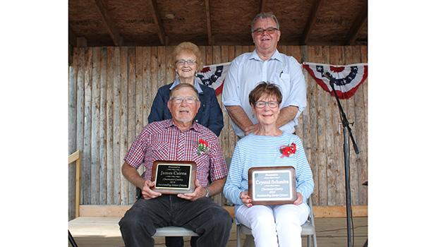 """James """"Jim"""" Cairns and  Crystal Schmitz were honored at the Clearwater County Fair last Saturday morning. They were named the County Outstanding Citizens this year. Standing are the Committee Co-chairpersons Dee Strandlien and Al Paulson."""