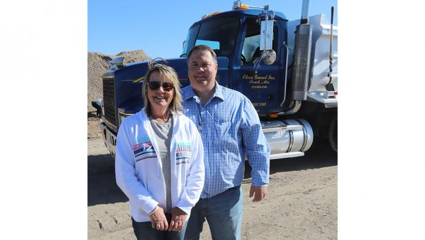 Susan and Curtis Olson at their Trail plant Open House.