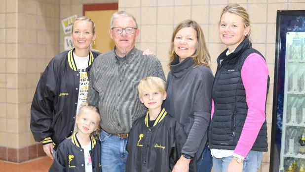 Glenn Rettmann was honored with a plaque in his honor at the Clearbrook-Gonvick School. With him from left to right: daughter Brig Rettmann Bergquist and grandchildren Louella and Rett, wife Sherry and daughter Lindsey Rettmann.