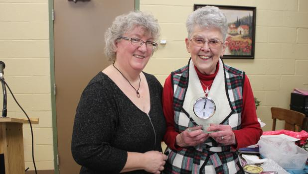 Tamara Edevold with the Clearwater County Historical Society presents Elaine Johnson the First Lady of the year award.