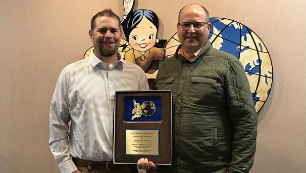 Dana and Ethan Johnson with their 2021 award.