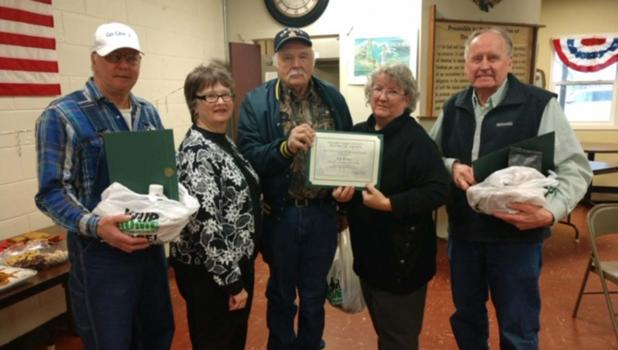 "At its annual meeting on January 26, the Clearwater County Historical Society honored its ""2019 Friends of the Museum."" 2019 Friends of Museum each received a certificate of appreciation and a gift basket filled with items made in Clearwater County. From left to right: Paul Syverson,  Donna Rae Jacobson, Ken Braaten, Tamara Edevold executive Director and Steve Wynkoop."