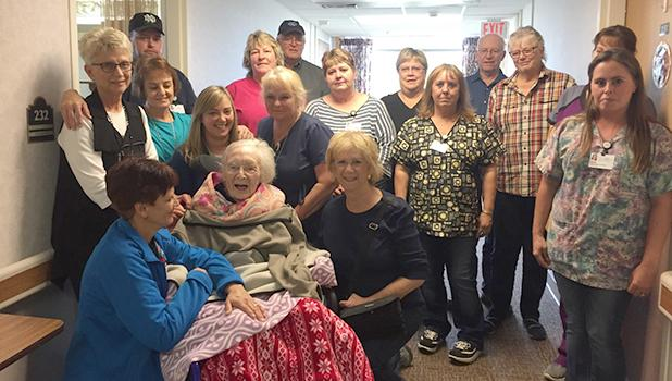 Enice Nordlund was the first resident to leave the Good Samaritan Center in Clearbrook after the meeting that was held to close the facility. She will be 104 on November 29. Shown with her are family and staff from the center wishing her well.
