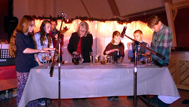 """""""Hallelujah Song Christmas"""" with unique music on glasses filled with various amounts of water was played by the FHL Academy. Included in the musical group were Elizabeth Becket, Rosie Cassibo, Carter Knutson, Dwayne Knutson,  Elisabeth Paavola, Iris Paavola and JoyPaavola."""