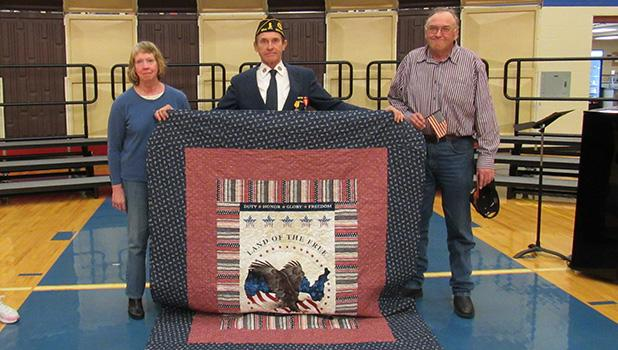 Receiving a Quilt of Valor from the E. Polk County Chapter on Friday during the Veterans Day program at Win-E-Mac School was Boyd Oppegaard. Boyd entered the U.S. Navy on July 1, 1971 thru July 1, 1974.