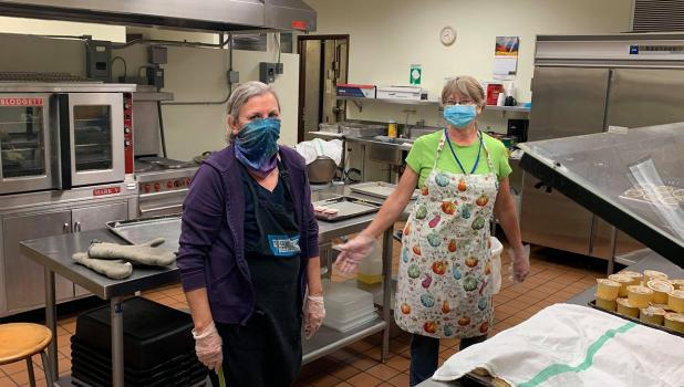 Grygla School cooks, Darlyne Roen and Jean Foss, stop for a quick picture in between the breakfast and lunch prep on Monday morning. Photo courtesy of Travis Smith