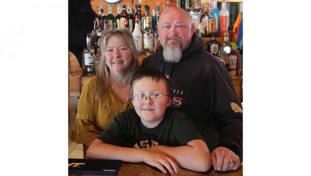 Randy and Lori Stephan are pictured with their youngest son, Johnathan. Photo by Grygla Eagle Newspaper