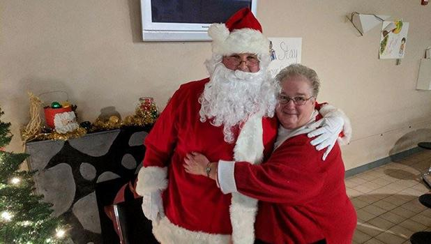 A special visitor from the North Pole even showed up and was greeted with a hug from Bonnie Nelson!