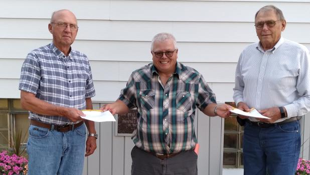 Grygla Lion's President Lon Englund presented Richard Engelstad (left) and Ronald Engelstad (right) with their awards as Grygla Lion's charter members. The club was started in 1971, 50 years ago!