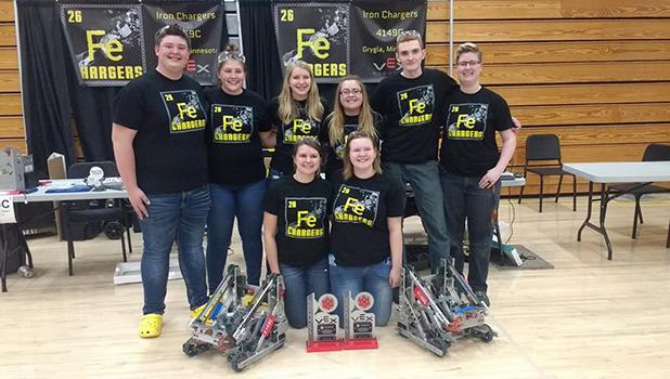 The 4149C and 4149G teams allied to win the entire tournament at NCTC last Saturday. They are, in front, Trystan Jelle and Bailey Watne. In back, L-R: Jake Ahlbeck, Abby Kiesow, Elise Monson, Julianne Nordby, Chris Luttrell and Olivia Tykward.  The Iron Chargers 4149C won both the Robot Skills Champion award and the Excellence Award! C Team members are Elise Monson, Trystan Jelle, Abby Kiesow, Jake Ahlbeck.