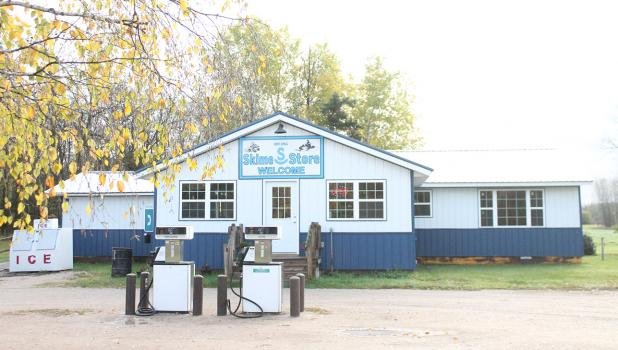 With new white and blue tin, the Skime Store closely resembles its past version. Along with new siding, the store also got new windows, a new roof and some updates inside. Photo by Grygla Eagle Newspaper