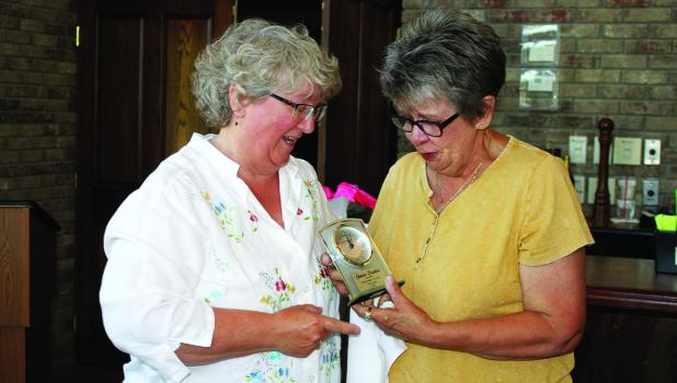 Tamara Edevold presenting the 2021 First Lady of the Year, Sharon Braaten with her special award last Saturday in Bagley.