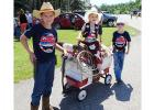 The First Place Award in the Trail Kids Parade on July 4th went to these well dressed cow-kids and their bull.  Luke, Abby and Adam Schroeder (Melander family) entry featured a very creative bull made from a barrel body with a horned bovine skull head, saddled up and mounted in a little red wagon.