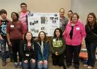 Pictured are RLCC's River Watch members along with their poster for the River Watch Forum at the University Minnesota Crookston. (Back) Nick Plante, Erin Jones, Marcus Styles, Brandi Jensen, Shawnee Styles, and Katheryne DeHate. (Front) Lyndsey Morris, Shelby Gunderson, Billie Jo Gryskiewicz, and their advisor Ms. Shelley Steva.