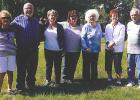 Seven members of the Gulbranson Family from left to right: Alice Cassibo, Robert Gulbranson, Sandy Dombeck, Tammye Cleveland, Donna Solberg, Sharon Lang and Richard Gulbranson attending the flag dedication.