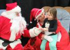Annabelle Schulz was a bit shy with Santa during her visit with he and Mrs. Claus last Saturday during Santa Claus Day sponsored by the McIntosh Community Club.