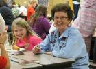 Everyone's favorite Grandma, Dorothy Sandberg sat with Ella Strom during Bingo for Books last Monday night at WEM School.