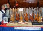 Bud and Marlys Larsen with their display of Hardanger Fiddles.
