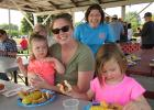 Stephanie, Ava and Addie Frisk were enjoying some fresh sweet corn during the McIntosh Community Club Corn for Kids event last Thursday, when out of nowhere, they were photo-bombed!