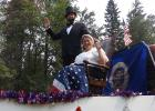 Mike & Jennifer Phaller (Abe Lincoln & Betsy Ross) wave at the crowd at the Debs Parade.