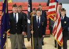Color Guard at the Veteran's Day Program in Oklee: (Front) John Lessard, Vincent Dessellier and Don Brown, (Back) Einar Kvasager, Jan Dulka, Bennett Larson and Leslie Hofstad, members of the American Legion.