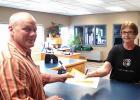 Debbie Lewis Chief Deputy Auditor/Treasurer of Clearwater County hands Matt his receipt. He is now officially running.