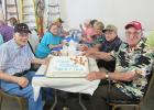 Lloyd Schleicher and Clifford Bartz each celebrated birthdays on July 15th at the McIntosh Heritage and Arts Center Heritage Homestead event at the Curt Bartz farm where there was a hearty breakfast served to all, and birthday cake too!