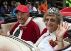 King and Queen for the 40th annual Lake Itasca Region Pioneer Farmers Show were Earl and Jeannine Hemmerich of Nisswa. They were driven in Everett Willberg's restored red Cadillac. Earls father Roy set up the saw mill and later donated the land and the mill to the Pioneer grounds which has been a working display for many years.