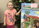 Prize winner at the Northern State Bank in Gonvick was Alice Brenton with a Giant Cardboard Train to color.