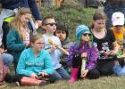 The RLCC Fifth graders holding their canoes before launching them in the Clearwater river.