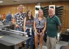 Visitors from three countries toured Richards Publishing Company print shop, (the Leader-Record) in Gonvick. With owner Dick Richards were Jelmer Van Der Zee from the Netherlands, Rosaleen Mills from England and Louise Burton from Wales.