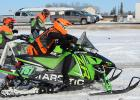 Damen Bakke runs his sled out of the fuel stop, you must walk/run beside the sled while in the fuel stop for safety reasons. Photo credit Mandi Bakke.