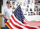 Ken Brien showing the 48 star flag that was found in the stairway of the bell tower at Our saviors Lutheran church in Leonard.