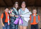 The 4-H Fashion Revue was part of the Clearwater County Fair. Champions in Grades 9 and up were Tessa Tramm with the Constructed Clothing, the long dress and MacKenzie Dahl in the short outfit with the Purchased Clothing class. Helpers for the evening were Hayden Hood on the left and Micah Tramm on the right.