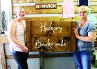 Kelly Melin, and her mom Joni Bjerklie show off the new sign, created by them, that will be hanging outside the newest store on Main Street, Gonvick.