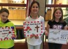 """4th Grade Poppy Poster winners at the Clearbrook-Gonvick Elementary School were from right to left:  1st - """"Remember Them"""" - Mysten Dalhke, 2nd - Seneca Johnson and 3rd - Blayten Benson."""