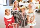 Olivia Basinger, Morgan Basinger, Lainey Fawver and Emma Fawver were very happy to model the dresses made in the 1980's.
