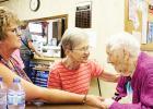 Gail Kotrba and Dorothy Dyrseth visit with Edna McEnelly.