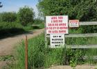 "The McIntosh ""Green Dump"" is clearly marked with signage stating that the area is used for yard waste only."