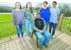 The Klema family, Kailey, Bailey, Daphne and Zappa with Billy seated at their home overlooking Pine Lake.